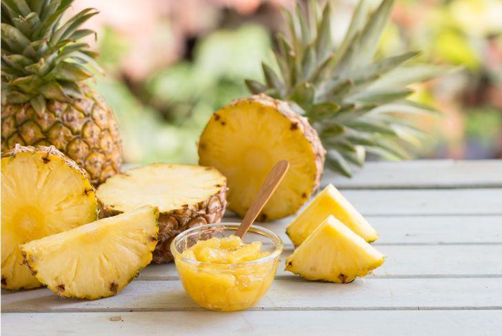 Homemade pineapple jam in glass bowl and pineapple slice