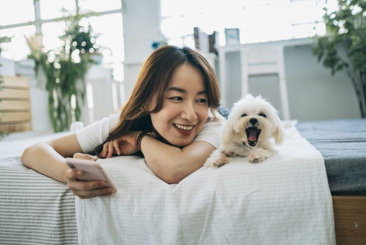 woman smiling next to maltese