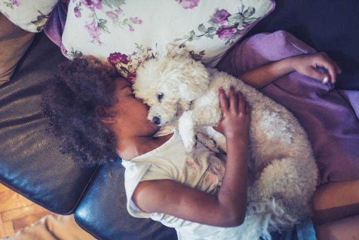 kids cuddle dog